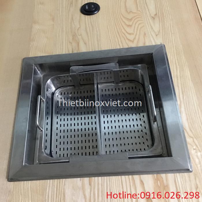 Bếp lẩu thang máy khi đặt trên bàn